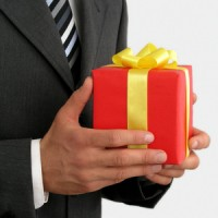 businessman holding gift